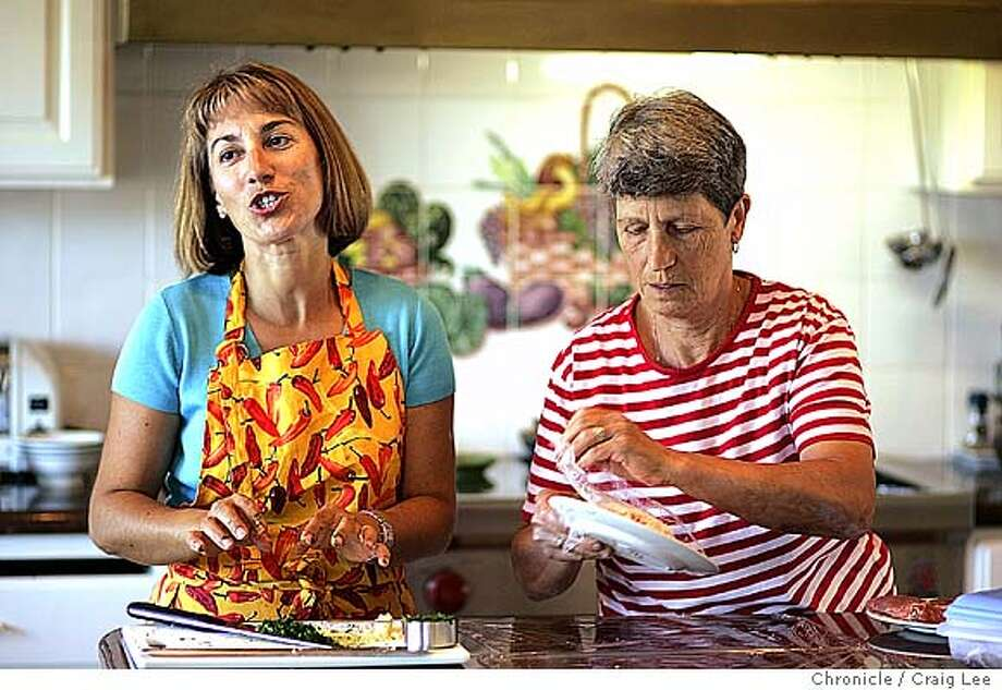 Rosetta Costantino (left) and her mother, Maria Dito (right), cooking Calabrian style dishes.  Event on 9/2/04 in Oakland. Craig Lee / The Chronicle Photo: Craig Lee