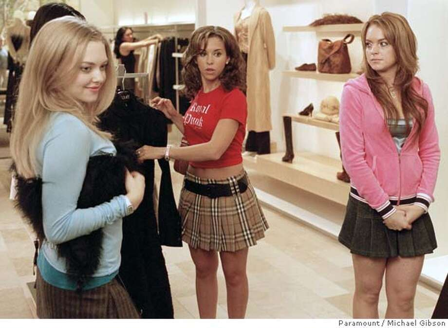 "(NYT20) UNDATED -- May 5, 2004 -- Adv. for Sunday, May 9 -- TEEN-GIRL-MOVIES-2 -- From left, Amanda Seyfried, Lacey Chabert and Lindsay Lohan in Paramount Pictures 2004 film, ""Mean Girls."" Last week, in a rare, unlikely triumph of pink sweaters and schoolyard crushes over gleaming guns and thunderous explosions, two out of the three top-grossing movies were coming-of-age stories: Gary Winick's ""13 Going on 30"" and Mark Waters' ""Mean Girls."" (Michael Gibson/Paramount Pictures/ Photo: Michael Gibson"