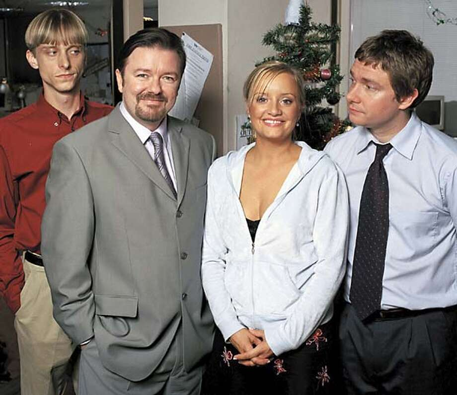 GOODMAN21 Picture Shows: (l-r) Gareth Keenan (MACKENZIE CROOK), David Brent (RICKY GERVAIS), Dawn (LUCY DAVIS) and Tim (MARTIN FREEMAN) in The Office. � BBC 2003