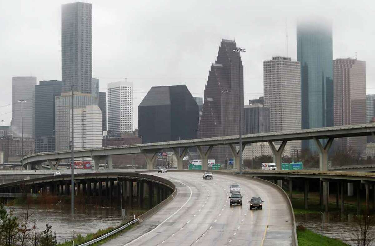 Cars drive north on I-45 from downtown as they cross over a swollen White Oak Bayou near the Quitman overpass in 2012. Fifteen bridges in Houston are rated structurally deficient, including three on the state-maintained system. That includes the northbound Interstate 45 bridge over White Oak bayou.
