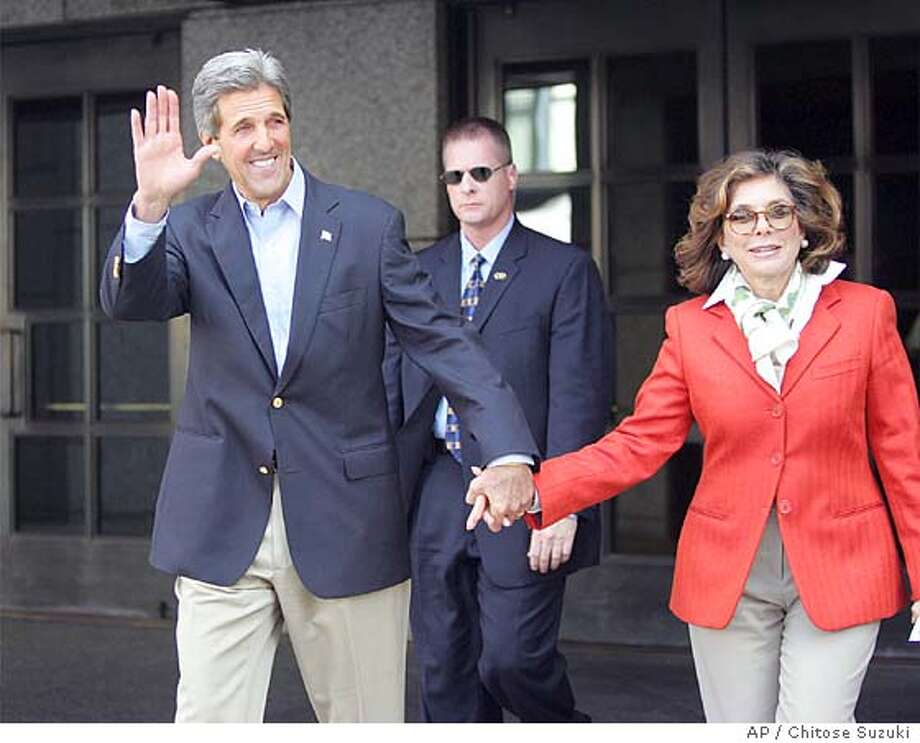 Democratic Presidential candidate Sen. John and his wife Teresa Heinz walk back their car after they attended a Mass at Saint Francis Chapel at Prudential Center in Boston, Sunday, Sept. 19, 2004. (AP Photo/Chitose Suzuki) Photo: CHITOSE SUZUKI