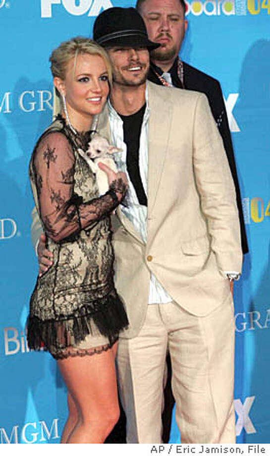**FILE** Britney Spears, holding her dog, and her husband, Kevin Federline, pose on the red carpet at The 2004 Billboard Music Awards in this Wednesday, Dec. 8, 2004 file photo, held at the MGM Grand Garden Arena in Las Vegas. After six months of marriage to the pop star, Kevin Federline is emerging from Spears' shadow. On the March 2005 cover of Details magazine, the former backup dancer is for the first time stepping out to reveal something about the man known as Britney Spears' second husband. (AP Photo/Eric Jamison, FILE) Photo: ERIC JAMISON
