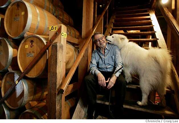 Ridge Vineyards in the Santa Cruz Mountains. Paul Draper, longtime winemaker and part-owner, with his dog, Bodhi, in the barrel room.  Event on 2/3/05 in Cupertino. Craig Lee / The Chronicle Photo: Craig Lee