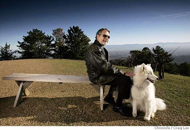 Ridge Vineyards in the Santa Cruz Mountains. Paul Draper, longtime winemaker and part-owner, with his dog Bodhi. They are on the vineyard grounds where you can get a overview of Silicon Valley from up there.  Event on 2/3/05 in Cupertino. Craig Lee / The Chronicle Photo: Craig Lee
