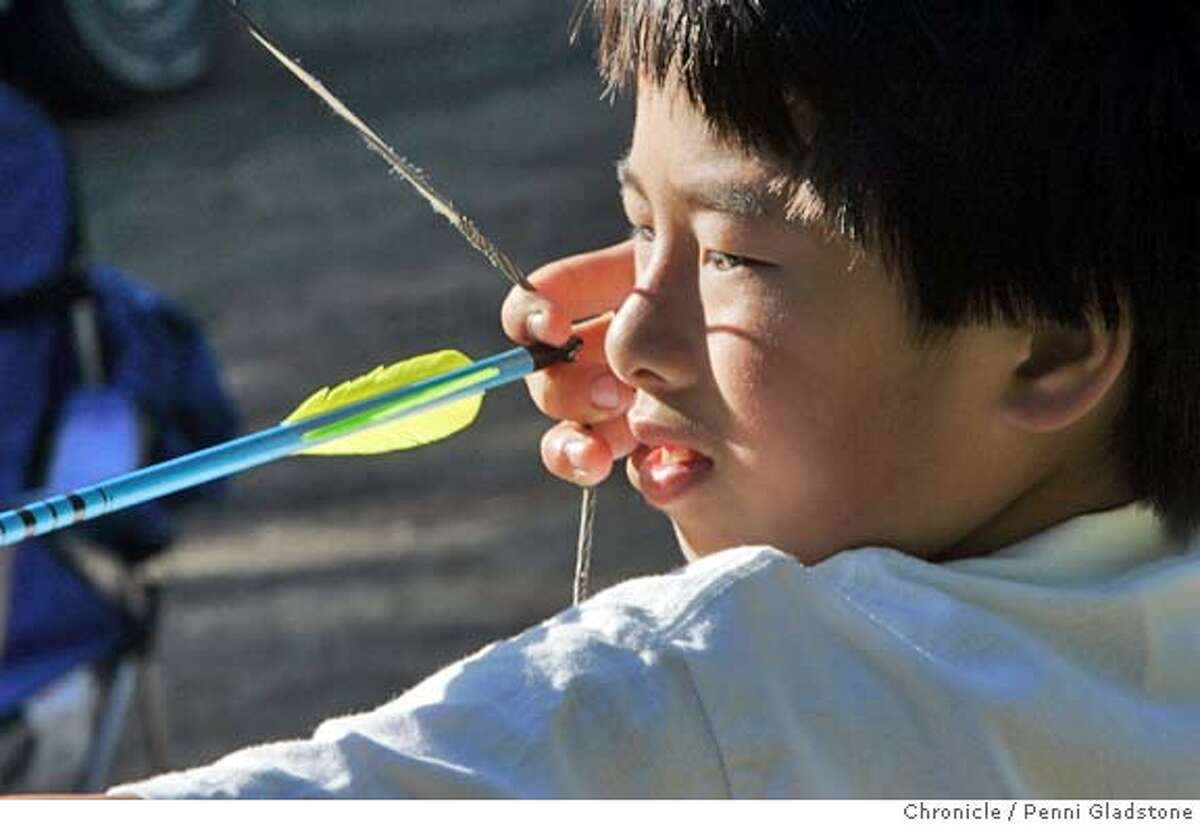Kenny Wong age 11 has been shooting since he was 8 yrs old.SAN FRANCISCO Arrchers perform outrach to attract people to the sport. show here at Sharp Park. 9/6/04 in Pacifica. Penni Gladstone / The Chronicle