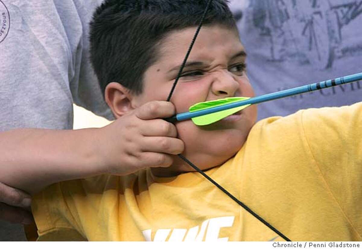 this the the third time for Nicholas Sebastiani age 6 of Belmont to be shooting. An instructor steadies him. SAN FRANCISCO Archers perform outrach to attract people to the sport. show here at Sharp Park. 9/6/04 in Pacifica. Penni Gladstone / The Chronicle