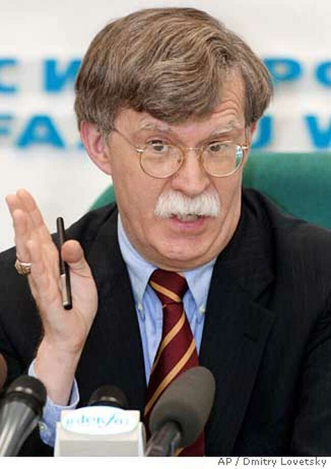 "U.S. Undersecretary of State John Bolton speaks at a news conference in Moscow, Tuesday, Feb. 19, 2002. Bolton said that U.S. and Russian negotiators are working ""under pressure"" to solve their differencies and make a nuclear arms cuts deal ready by presidential summit in May, while the two nations also remain at odds over Russian cooperation with Iran. (AP Photo/Dmitry Lovetsky) Photo: DMITRY LOVETSKY"