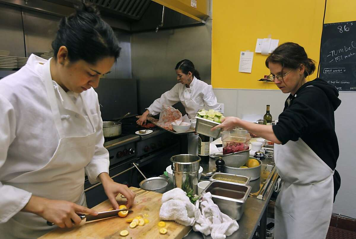 Dominica Rice (center), owner and chef at the Cosecha Cafe, prepares the lunch menu with two of her employees, Silvia McCollow (left) and Clara Rice, who is not related to the chef, in Oakland, Calif. on Friday, Jan. 13, 2012.