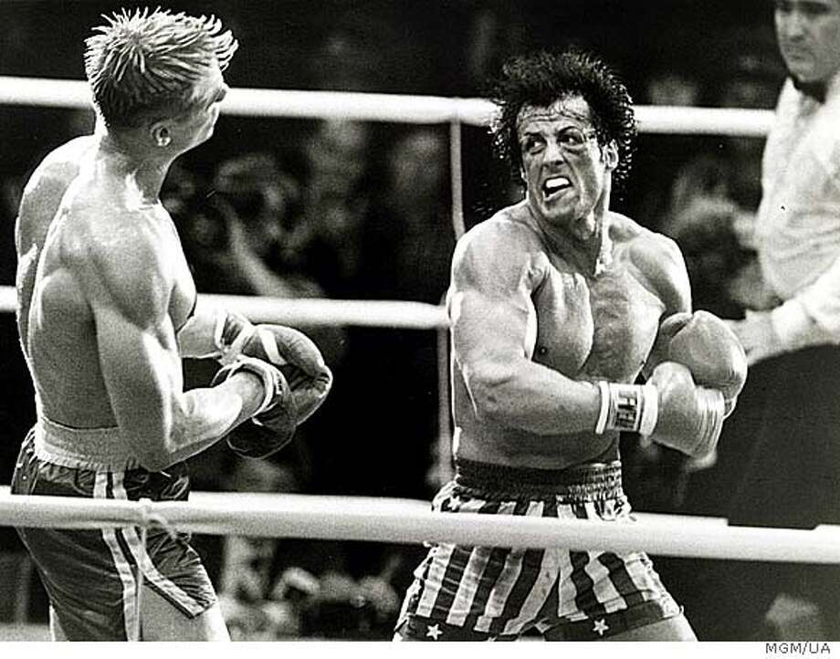 Rocky (Sylvester Stallone) prepares to deliveer a staggering left to the head of Ivan Drago (Dolph Lundgren, left) in . Photo: Mgm/ua Entertainment Co.