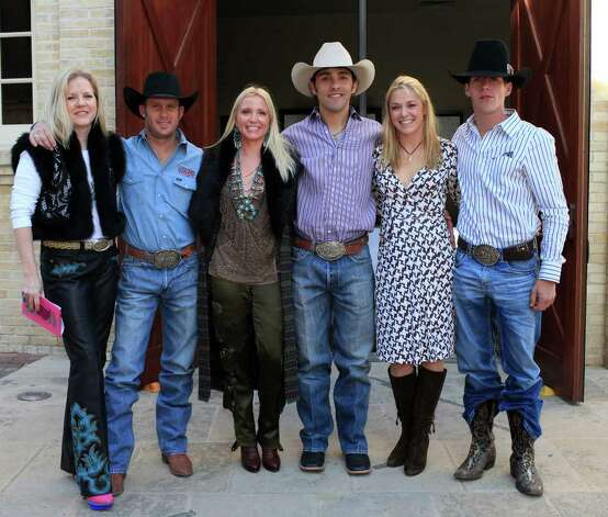 Event chairwoman Heather Kraft, from the left, with cowboy model Todd Yarborough, event chairwoman Lee Lee, cowboy model Will O'Quinn, event chairwoman Sara Walker and cowboy model Josh Byerley get togther at the San Antonio Stock Show & Rodeo 7th Annual Cowgirls Live Forever luncheon and fashion show, honoring Olive Anne Kleberg Thursday, January 19, 2012 at the Pearl Stable in San Antonio. Photo: J. MICHAEL SHORT, SPECIAL TO THE EXPRESS-NEWS / THE SAN ANTONIO EXPRESS-NEWS