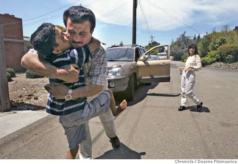 Saleh gives Raheem a hug before Raheem leaves for a driving lesson with Leslie Troutner (right). He received his driver's learners permit the day before. The Troutners have taken in Saleh and Raheem as family. Through an international rescue mission, Saleh Khalaf, 9, on the brink of death after an explosion, was flown from Iraq to Oakland Children's Hospital along with his father, Raheem. Deanne Fitzmaurice / The Chronicle  THIS IS PART OF A PROJECT ABOUT THIS IRAQI BOY. DO NOT USE ELSEWHERE. Photo: Deanne Fitzmaurice