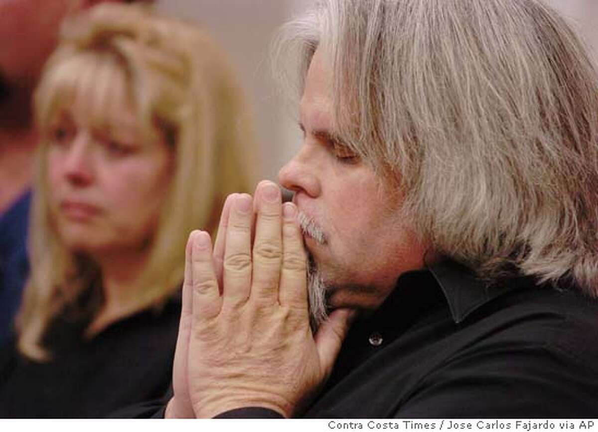 Michael Carrington and his ex-wife, Debbie Smith, the parents of Matthew William Carrington, listen to Butte County District Attorney Michael Ramsey speak during a press conference at the Chico Police Department, Thursday, March 3, 2005, in Chico, Calif., where it was announced that four California State University fraternity members were charged with involuntary manslaughter in the death of 21-year-old Carrington. (AP Photo/Contra Costa Times, Jose Carlos Fajardo)