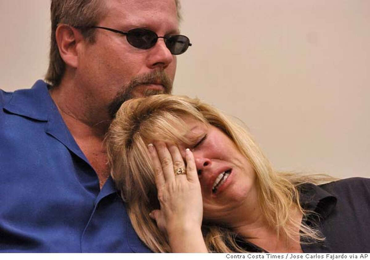 Debbie Smith, mother of Matthew William Carrington, is consoled by her husband, Greg Smith, during a press conference at the Chico Police Department, Thursday, March 3, 2005, in Chico, Calif., where it was announced that four California State University fraternity members were charged Wednesday with involuntary manslaughter in the death of 21-year-old Carrington. (AP Photo/Contra Costa Times, Jose Carlos Fajardo) MAGS OUT, , NO ARCHIVEING, TV OUT, INTERNET OUT, SF BAY AREA MUST CREDIT