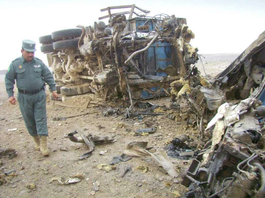 "An Afghan police official inspects the scene where a truck was hit by a roadside bomb on the outskirts of Lashkar Gah, Helmand province south of Kabul, Afghanistan, recently. The blast killed four Afghan civilians, the Ministry of Interior said. Occurrences like this, says former Riverside resident Zaid Siddig, are a part of life - and death- in Afghanistan, but people, in large part, go on with their daily routines. ""Insecurity is a factor but does not impact your daily life,"" says Siddig. ""You just go on from day to day."" (AP Photo/Abdul Khaleq) Photo: Abdul Khaleq, Associated Press / AP"