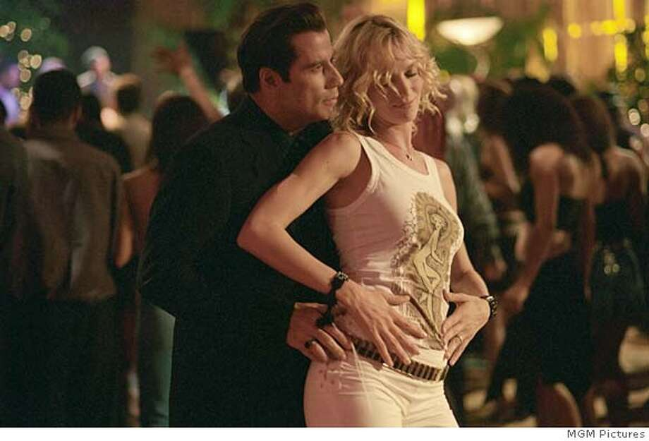BECOOL04 Chili (JOHN TRAVOLTA) and Edie (UMA THURMAN) hit the dance floor in MGM Pictures� comedy BE COOL. CR: Ron Phillips