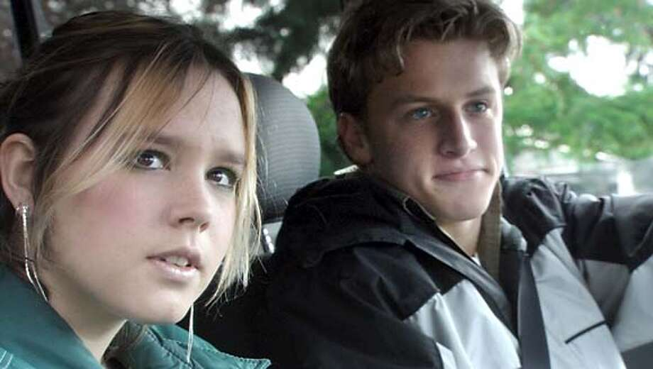 EVERGREEN10 Henri (Addie Land) and Chat (Noah Fleiss) talk in Chat's car. Credit: Evergreen Films, Inc.