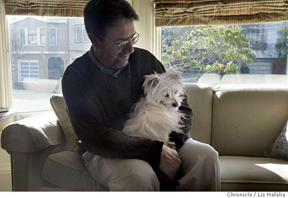Steven Winn with the family dog, Como. Shot on 2/4/04 in San Francisco. LIZ HAFALIA / The Chronicle