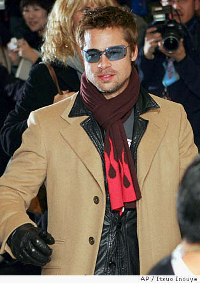 """Brad Pitt arrives at Narita International Airport in Narita, east of Tokyo, Wednesday, Jan. 12, 2005. Pitt, who is separating from wife Jennifer Aniston, arrived for the Japanese premiere of his new film """"Ocean's Twelve."""" (AP Photo/Itsuo Inouye) Photo: ITSUO INOUYE"""