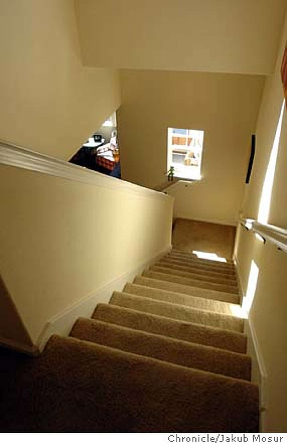 A staircase inside a Plan C model home at the Cotati Station on 9/2/04 in Cotati. JAKUB MOSUR / The Chronicle