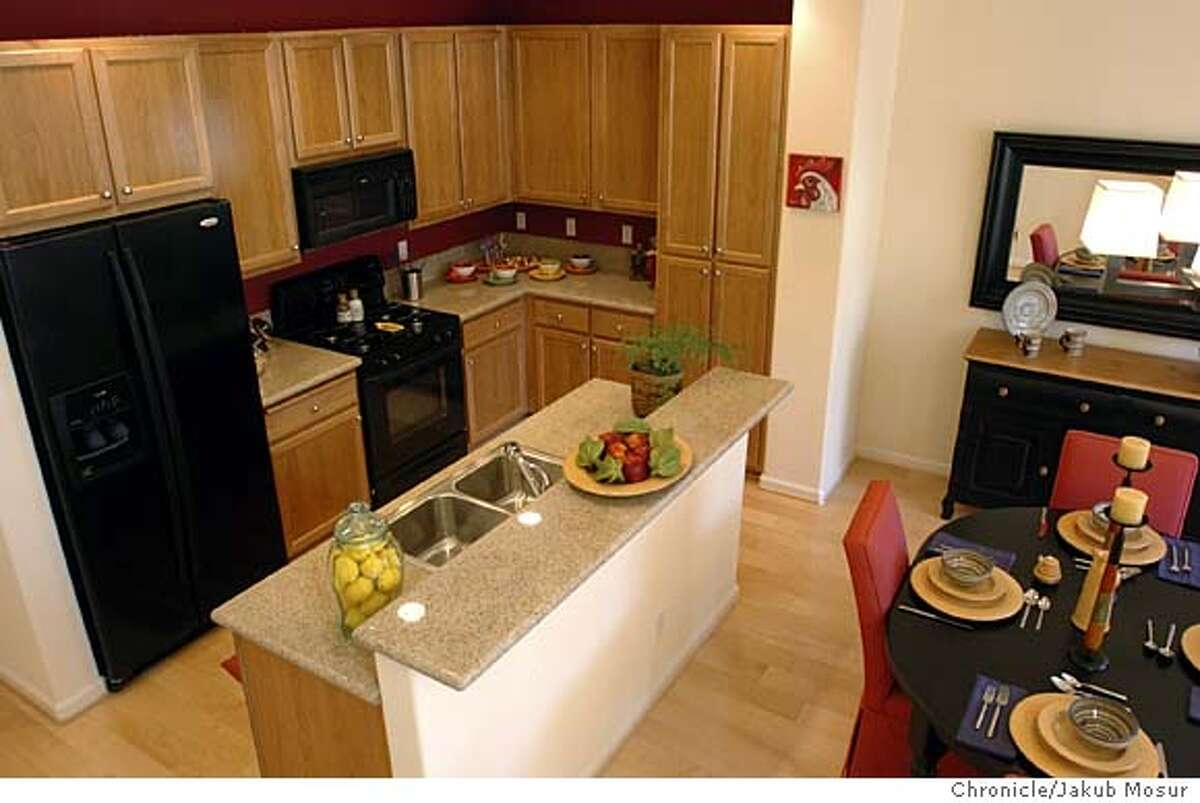 The kitchen as seen from the stairs inside a Plan C model home at the Cotati Station on 9/2/04 in Cotati. JAKUB MOSUR / The Chronicle