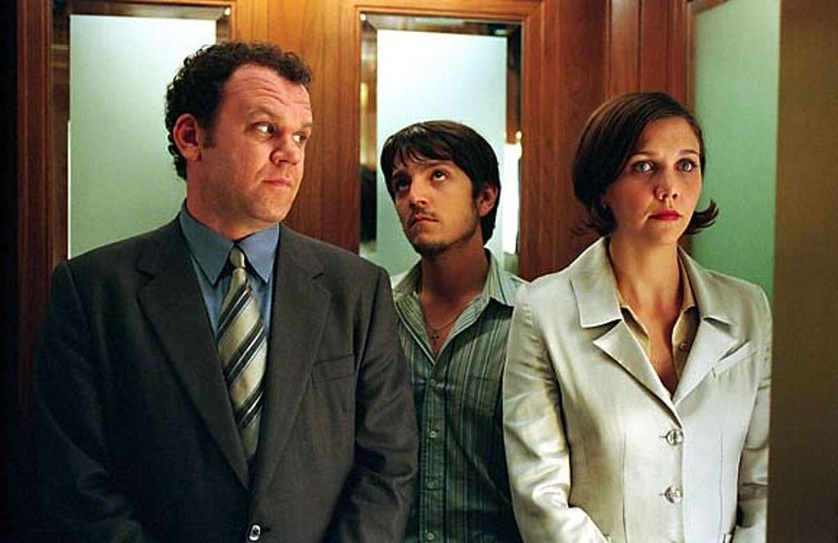 CRIMINAL10 John C. Reilly (left), Diego Luna (center), and Maggie Gyllenhaal star as Richard, Rodrigo, and Valerie in Gregory Jacobs' CRIMINAL. Suzanne Hanover/Warner Independent Pictures .
