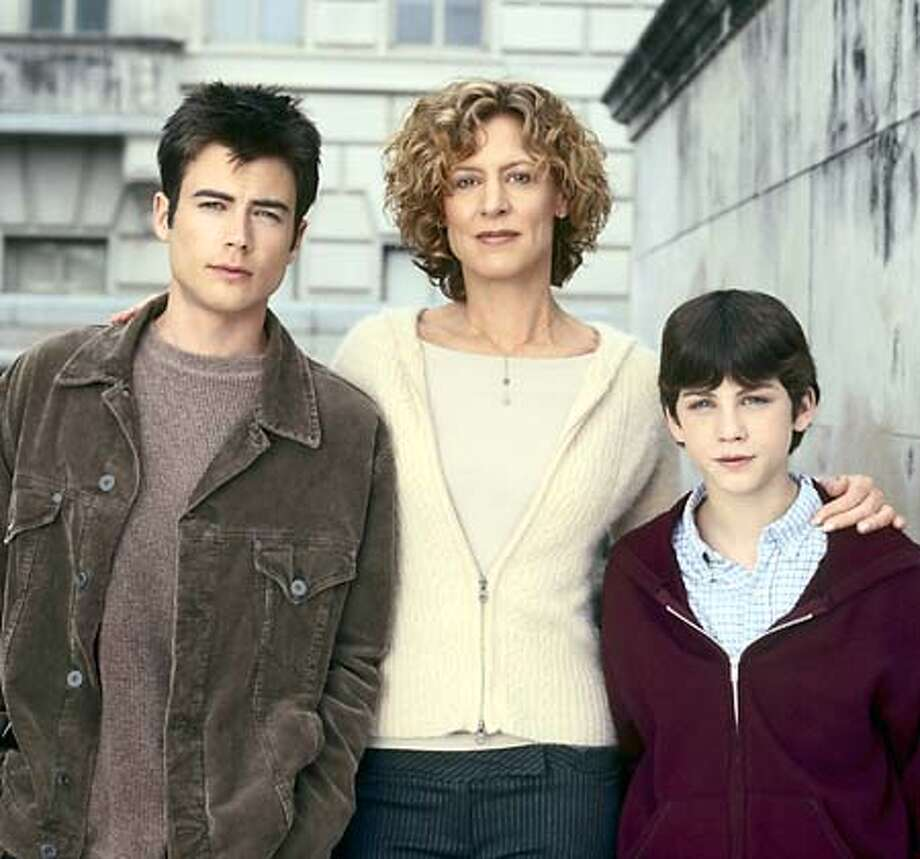 """** ADVANCE FOR TUESDAY, SEPT. 7 **Matt Long, left, as Jack McCallister, Christine Lahti as Grace McCallister and Logan Lerman as Bobby McCallister star in the new WB drama """"Jack & Bobby,"""" in this undated publicity photo for the new series which premieres at 9 p.m., EDT, Sunday, Sept. 12, 2004. (AP Photo/ The WB, Van Redin) HFR 09-07-04. ADVANCE FOR TUESDAY, SEPT. 7. Photo: VAN REDIN"""