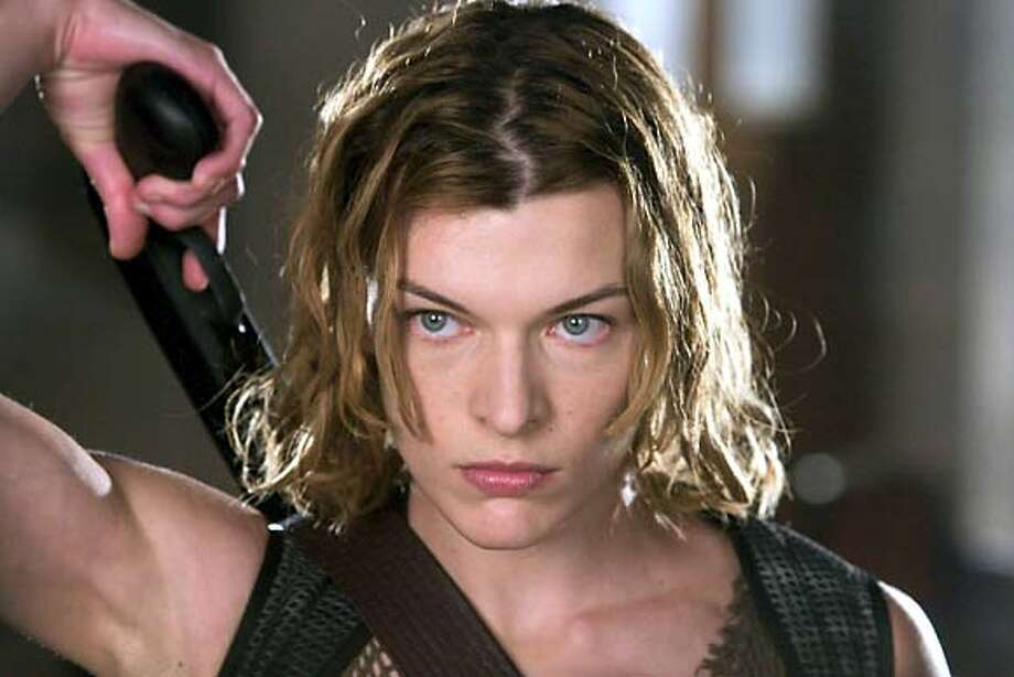 "Milla Jovovich stars as Alice, an elite military agent who finds herself stranded in the ruins of Raccoon City folowing a virus outbreak, which has turned the city's inhabitants into bloodthirsty zombies, in ""Resident Evil : Apocalypse."" (AP Photo/Rolf Konow) Photo: ROLF KONOW"