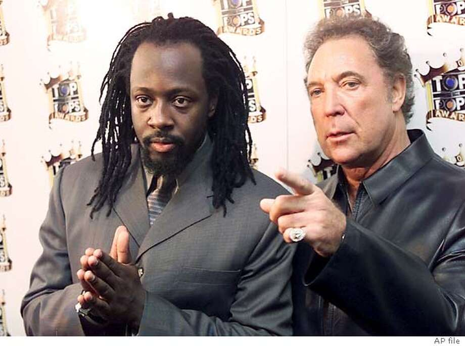 Welsh singer Tom Jones and Wyclef Jean, left, backstage at the Manchester Evening News Arena, for the first ever Top Of The Pops Awards Friday, Nov. 30, 2001. (AP Photo /Phil Noble) UNITED KINGDOM OUT MAGAZINES OUT Ran on: 08-17-2004  Among the artists who have recorded an updated version of &quo;Wake Up Everybody&quo; are, clockwise, from above, Missy Elliott, Mary J. Blige, Brandy, Wyclef Jean and Ashanti. CAT UNITED KINGDOM OUT MAGAZINES OUT PIC MADE AVAILABLE SATURDAY DEC 1 2001 Photo: PHIL NOBLE