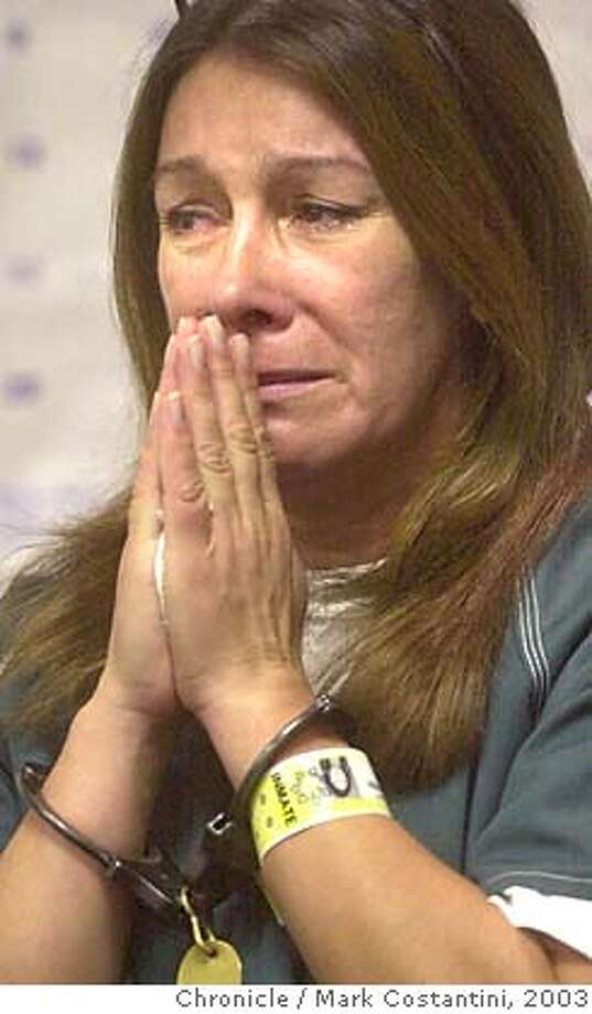 arraign_0051.JPG Photo taken on 11/13/03 in Walnut Creek.  Jimena Barreto, 45, prays while handcuffed whis being arrainged in CC Superior Court on charges she killed two children in a hit-and-run accident and was in possesion of cocaine.  CHRONICLE PHOTO BY MARK COSTANTINI MANDATORY CREDIT FOR PHOTOG AND SF CHRONICLE/ -MAGS OUT Photo: MARK COSTANTINI