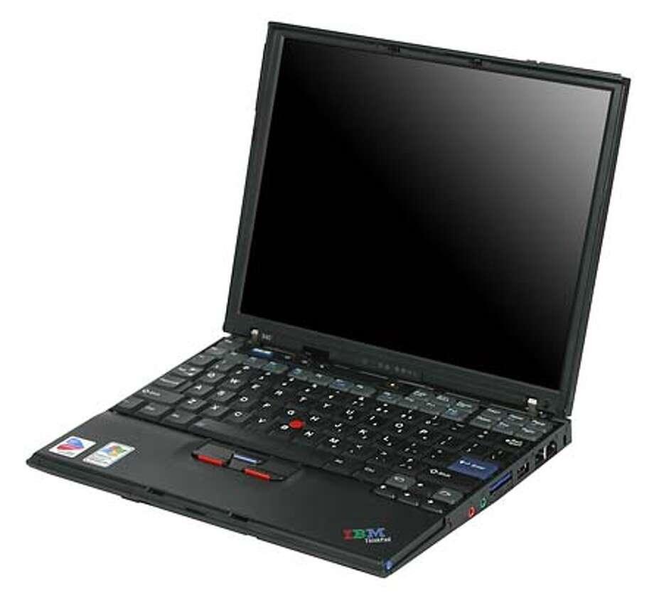 Photo of the new IBM ThinkPad X40, laptop computer.