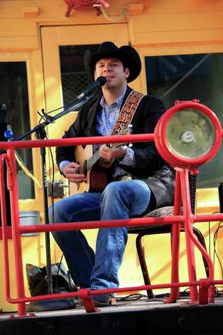 John Wayne Schulz sings at the San Antonio Stock Show & Rodeo 7th Annual Cowgirls Live Forever luncheon and fashion, honoring Olive Anne Kleberg Thursday, January 19, 2012 at the Pearl Stable in San Antonio. Photo: J. MICHAEL SHORT, SPECIAL TO THE EXPRESS-NEWS / THE SAN ANTONIO EXPRESS-NEWS