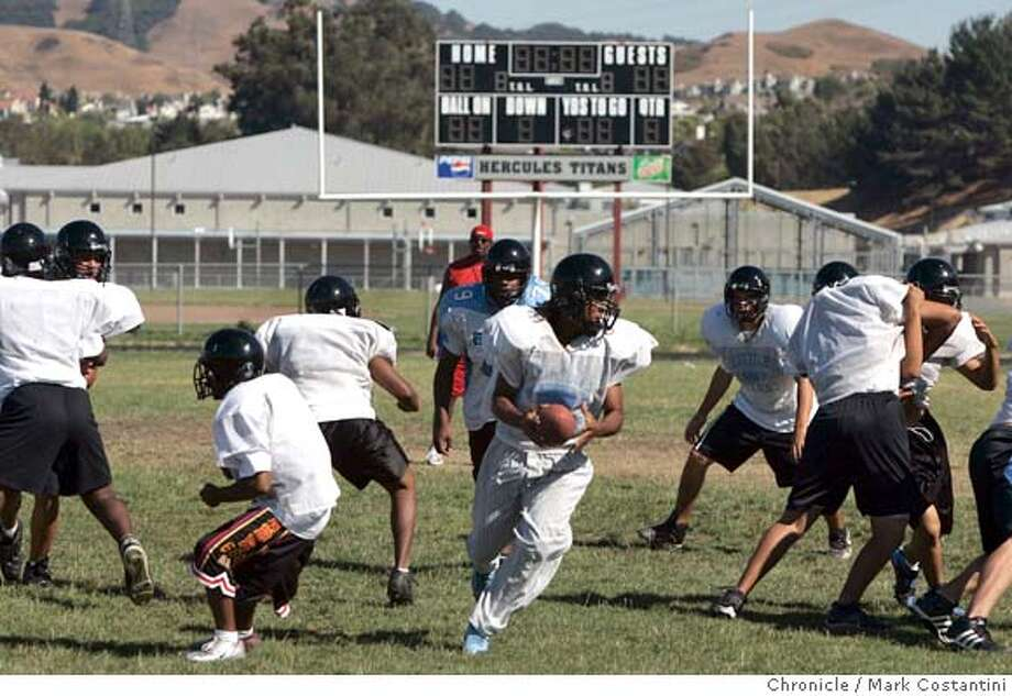 SCHOOL FOOTBALL TEAM PRACTICES AT HERCULES MIDDLE/HIGH SCHOOL IN HERCULES. FOR STORY ON THE FINANCIAL SITUATION AT THE WEST CONTRA COSTA COUNDY SCHOOL DISTRICT. Event on 9/4/04 in HERCULES. S.F. Chronicle Photo: Mark Costantini Photo: Mark Costantini