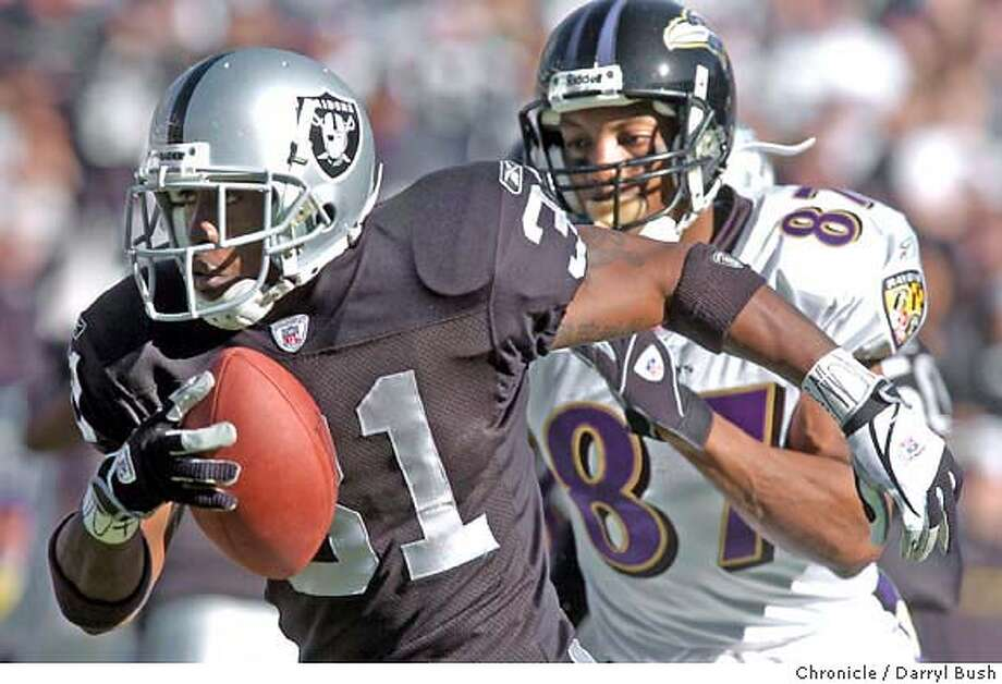 raiders15_056db.jpg  Oakland Raiders Phillip Buchanon runs back an interception he made in the 1st qtr. vs. Baltimore Ravens at Networks Associates coliseum. 12/14/03 in Oakland. DARRYL BUSH / The Chronicle MANDATORY CREDIT FOR PHOTOG AND SF CHRONICLE/ -MAGS OUT Photo: DARRYL BUSH