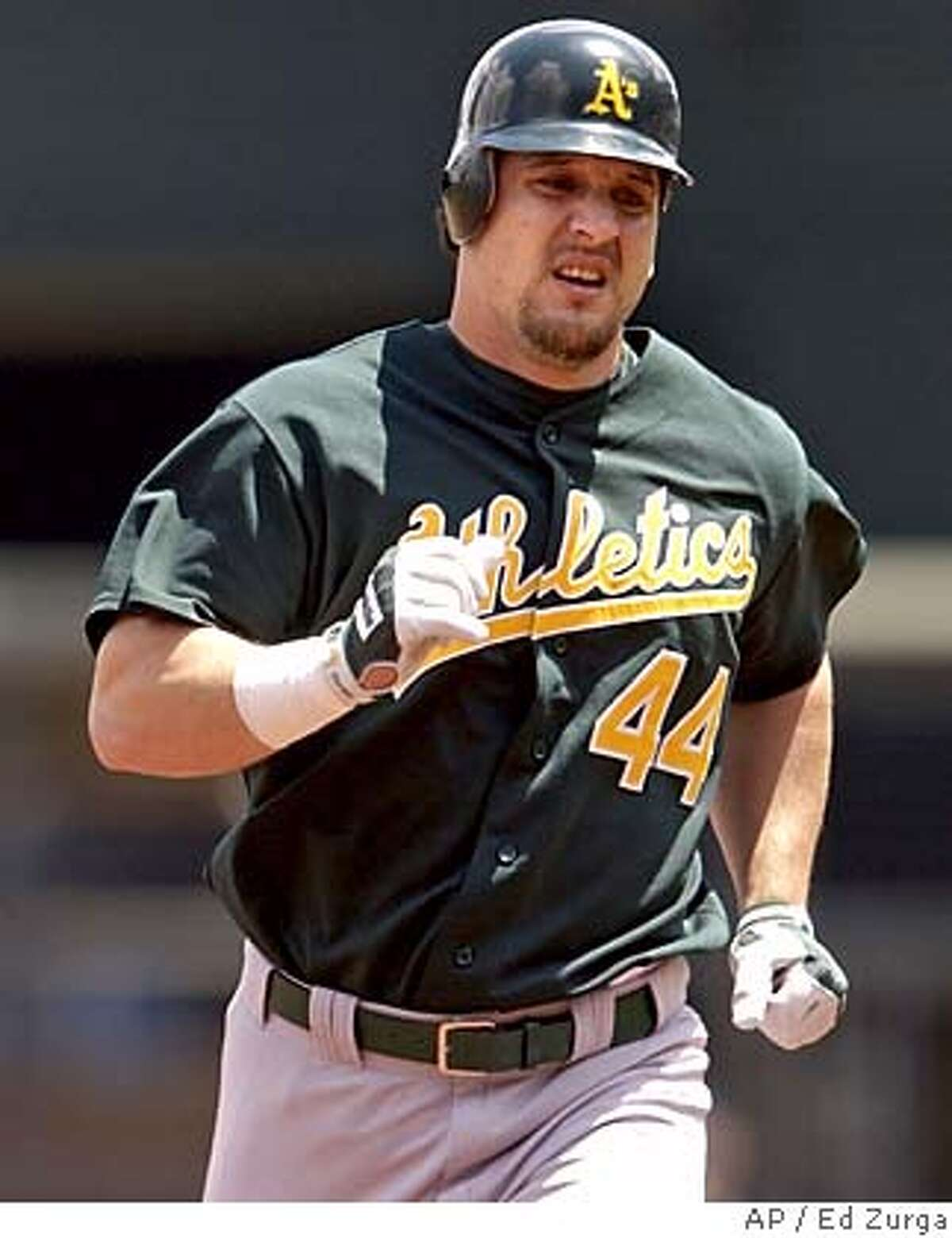 Oakland Athletics' Erubiel Durazo (44) prepares to round third past Kansas City Royals third baseman Desi Relaford after hitting a two-run home run in the first inning Tuesday, July 22, 2003, in Kansas City, Mo. (AP Photo/Ed Zurga) Durazo Durazo ProductNameChronicle Also ran 03/04/04 Erubiel Durazo suddenly has become a base stealer, having swiped three bases this spring -- matching his career regular-season total. DH Erubiel Durazo has a .347 average in spring training. CAT RESIZES AND MOVES INSIDE FOR 5STAR