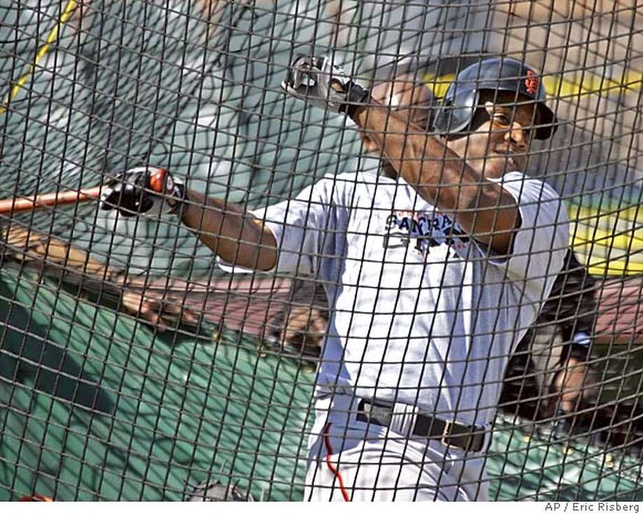 San Francisco Giants' Barry Bonds hits from the batting cage at Scottsdale Stadium during spring training in Scottsdale, Ariz., Sunday Feb. 27, 2005. Bonds faced live pitching for the first time this spring from Giants' closer Armando Benitez.(AP Photo/Eric Risberg) Photo: ERIC RISBERG