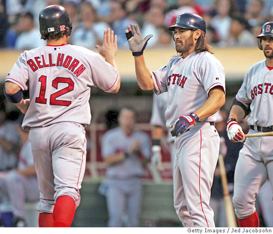 OAKLAND, CA - SEPTEMBER 8: Mark Belhorn #12 of the Boston Red Sox is congratulated by Johnny Damon #16 and Jason Varitek #33 after scoring on a David Ortiz single in the first inning against the Oakland Athletics during a MLB game on September 8, 2004 at the Network Associates Coliseum in Oakland, California. (Photo by Jed Jacobsohn/Getty Images) *** Local Caption *** Mark Belhorn;Johnny Damon;Jason Varitek Photo: Jed Jacobsohn