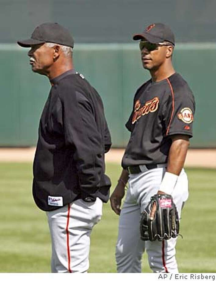 San Francisco Giants manager Felipe Alou, left, stands with his son, Giants right fielder Moises Alou, right, in right field at Scottsdale Stadium during spring training in Scottsdale, Ariz., Monday Feb. 28, 2005. (AP Photo/Eric Risberg) Photo: ERIC RISBERG