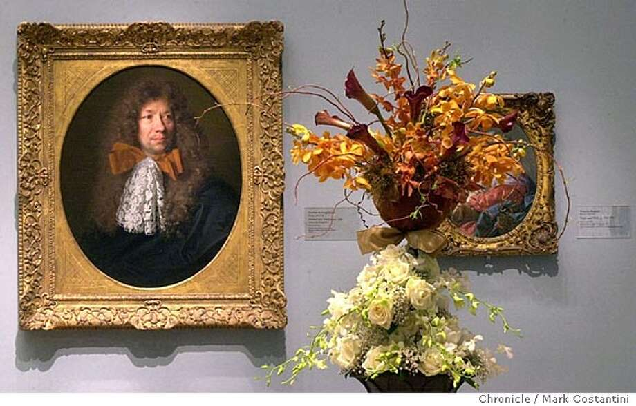 bouquetsxx_0095.JPG Photo taken on 3/15/04 in San Francisco.  Painting: Portrait of a Gentleman by Nicolas de Larfgierre.  Bouquets next to painting. Florist is CMM Design, Carolyn Musto of San Mateo. Flower arrangements juxtaposed with art the the Palace of the Legion of Honor -- this is for an advance for next year's fundraising event -- an yearly fundraiserr called Boquets d' Arte. CHRONICLE PHOTO BY MARK COSTANTINI Photo: MARK COSTANTINI