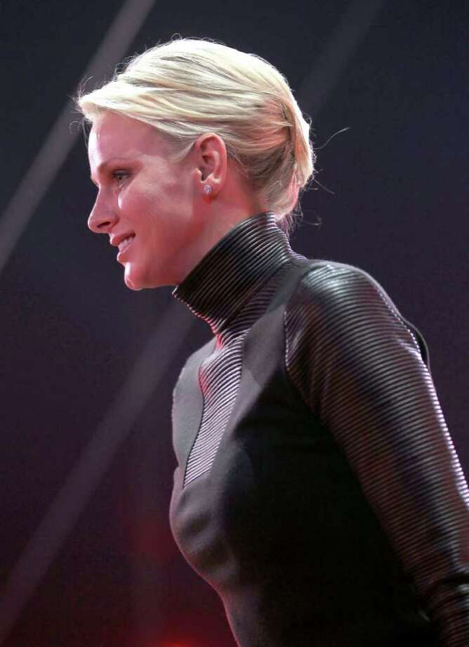 In this Tuesday, Jan. 24, 2012 photo, Prince Albert II of Monaco's wife, Princess Charlene arrives to deliver awards at the awards ceremony for the 36th edition of the Monte-Carlo International Circus Festival, in Monaco (AP Photo/Valery Hache, Pool) Photo: Valery Hache, Associated Press / AFP POOL