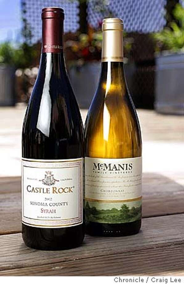 Bargain wines. 2003 McManis Family Vineyards River Junction Chardonnay.  2002 Castle Rock Sonoma County Syrah. Event on 8/27/04 in San Francisco. Craig Lee / The Chronicle Photo: Craig Lee