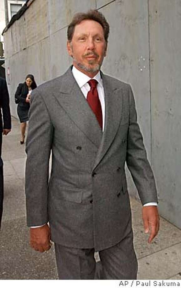 Oracle Corp. CEO Larry Ellison arrives at a federal courthouse in San Francisco, Wednesday, June 30, 2004. Ellison will testify about his company's $9.7 billion bid for rival business software maker PeopleSoft when he takes the witness stand in an antitrust trial challenging the proposed deal. (AP Photo/Paul Sakuma) Photo: PAUL SAKUMA