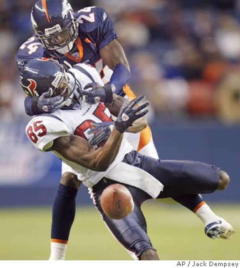 Houston Texans wide receiver Corey Bradford, front, drops the pass as he is wrapped up by Denver Broncos cornerback Champ Bailey in the first quarter of an NFL exhibition game in Denver on Friday, Aug. 27, 2004. (AP Photo/Jack Dempsey) Photo: JACK DEMPSEY