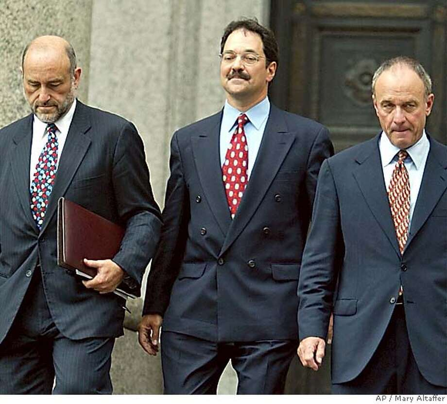 Former banker Frank Quattrone, center, leaves federal court in New York with his attorneys Mark Pomerantz, left and John Keker, Wednesday, Sept. 8, 2004, after he was sentenced to 18 months in prison plus two years probation after his conviction for obstruction of justice. (AP Photo/Mary Altaffer) Photo: MARY ALTAFFER