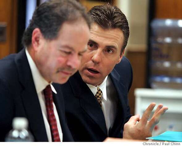 Bill Romanowski talked with his attorney Jeffrey Springer before the trail started. Opening statements in the civil trial against former Oakland Raiders player Bill Romanowski on 3/1/05 in Oakland, CA. Former teammate Marcus Williams filed a $3.8 million lawsuit against Romanowski after a practice field fight severly injured Williams.  PAUL CHINN/The Chronicle Photo: PAUL CHINN