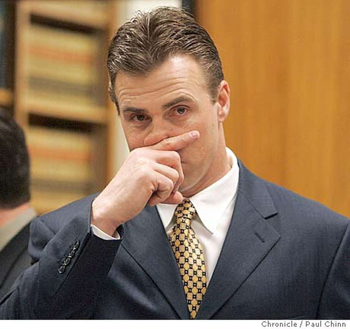 romanowski_047_pc.jpg Bill Romanowski conferred with his team of attorneys before the trail started. Opening statements in the civil trial against former Oakland Raiders player Bill Romanowski on 3/1/05 in Oakland, CA. Former teammate Marcus Williams filed a $3.8 million lawsuit against Romanowski after a practice field fight severly injured Williams. PAUL CHINN/The Chronicle MANDATORY CREDIT FOR PHOTOG AND S.F. CHRONICLE/ - MAGS OUT