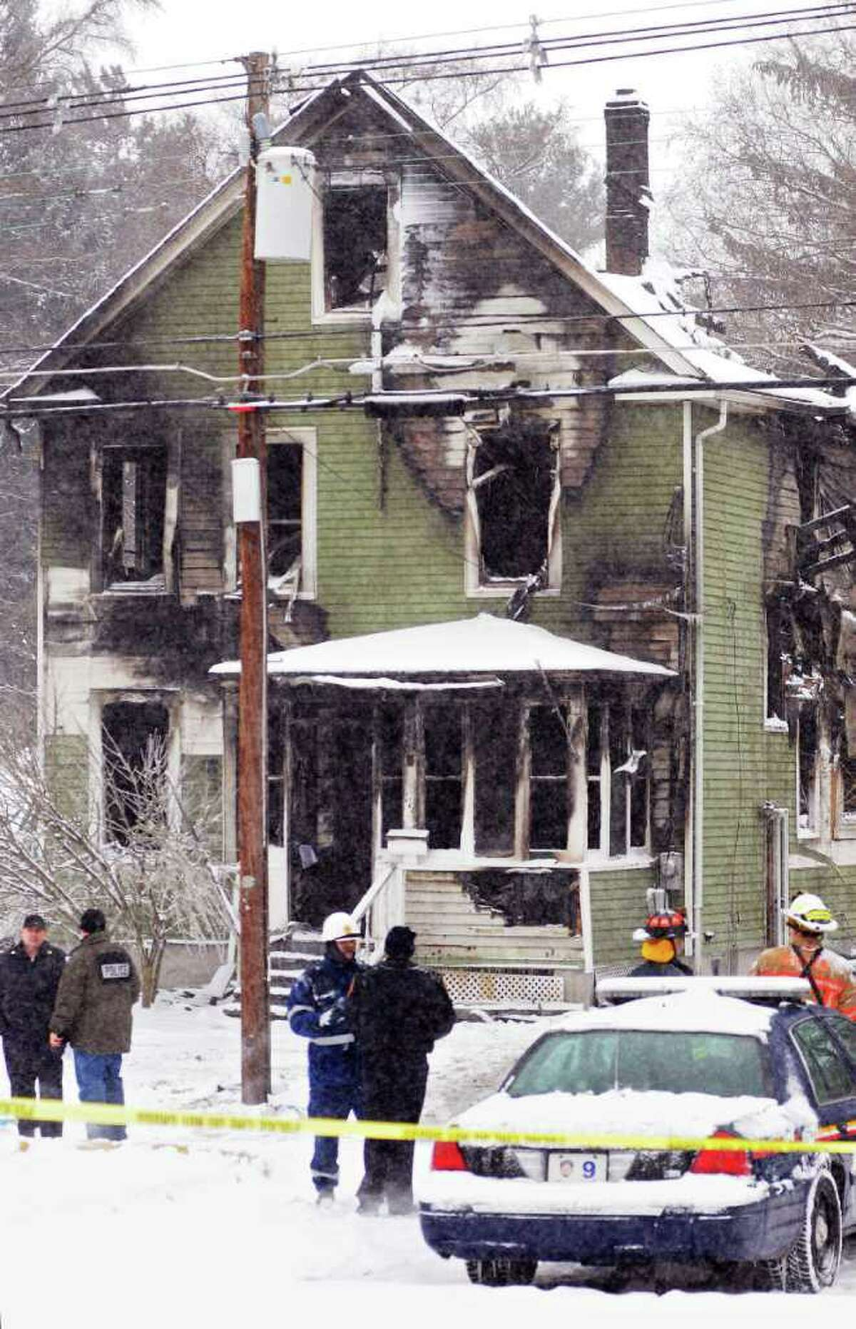 Darryl Bautista/Poughkeepsie Journal Town of Poughkeepsie Poilce and the Fairview Fire Department with other authorities at 112 Fairview Ave. in the Town of Poughkeepsie on Saturday, Jan. 21, 2012. Three people killed by the fire that tore through a private home being rented by Marist College students near campus. Kevin Johnson, 20, who graduated from New Canaan High School, was identified by friends as one of the victims of the fire. Johnson was not a Marist student. Eva Block, a 21-year-old Marist College student from Woodbridge, died of smoke inhalation, Poughkeepsie police told the Poughkeepsie Journal. The third victim was identified by the Journal as Marist student Kerry Fitzsimons, of Commack, N.Y