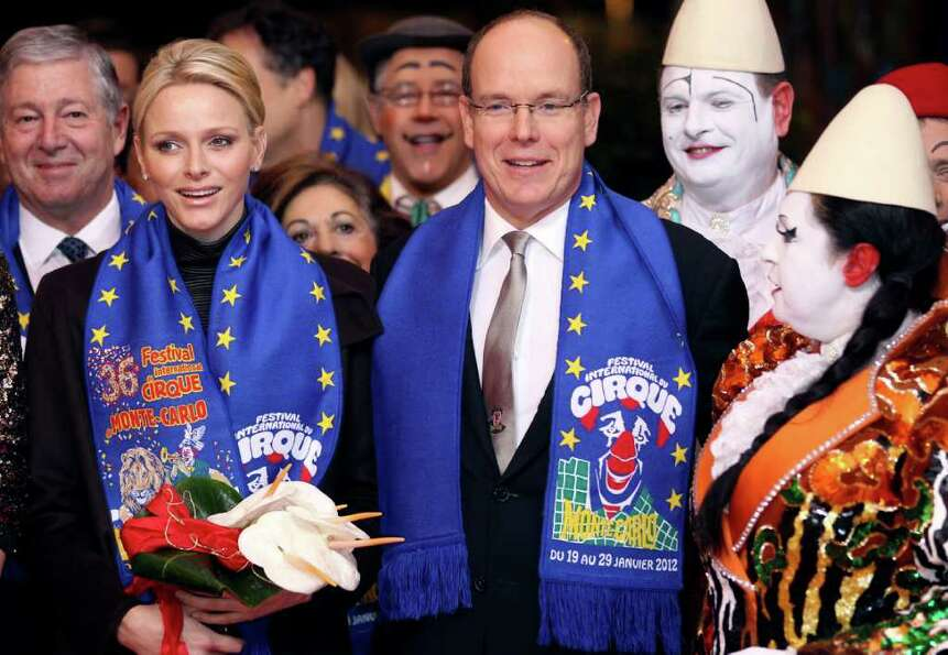 In this Tuesday, Jan. 24 , 2012 photo, Prince Albert II of Monaco and his wife Princess Charlene arr