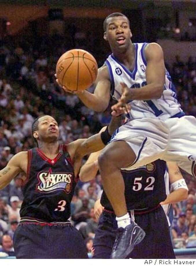 Charlotte Hornets' Baron Davis (1) makes a pass as Philadelphia 76ers' Allen Iverson (3) defends during the Hornets' 108-98 overtime win in Charlotte, N.C., Monday, April 24, 2000 in the first round of the NBA playoffs. The series is tied at one game apiece. (AP Photo/Rick Havner) Ran on: 02-27-2005  Baron Davis, who wore a No. 1 jersey for the Hornets, will ply his trade for the Warriors with a No. 5 on his jersey. Photo: RICK HAVNER