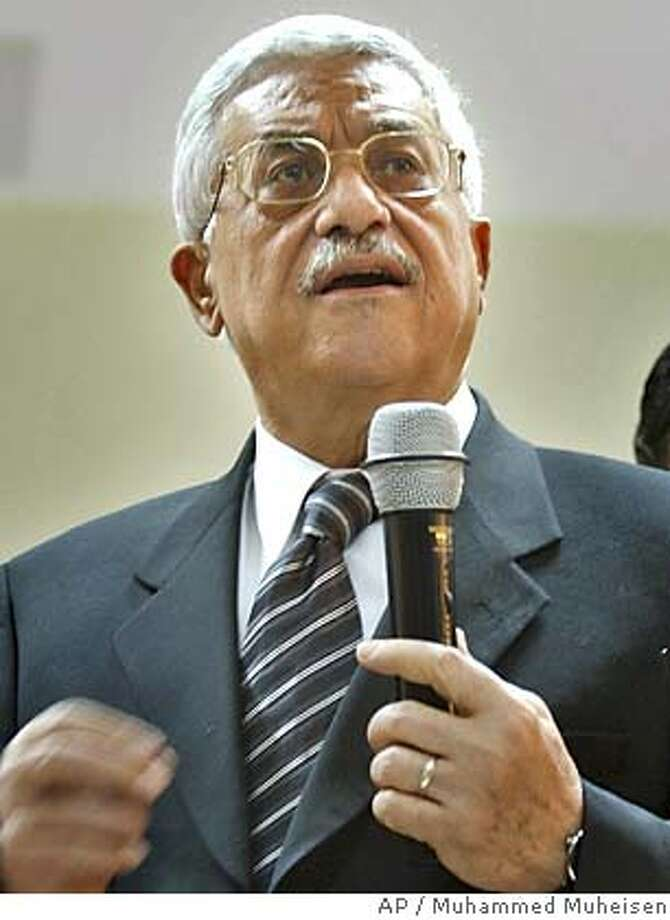 """Palestinian Authority President Mahmoud Abbas, also known as Abu Mazen, center, talks to journalists regarding Friday nights attack that killed four Israelis in Tel-Aviv at his office in the West Bank town of Ramallah, Saturday Feb. 26, 2005. Abbas met with Cabinet ministers and security chiefs Saturday to discuss a possible response, condemned the attack as """"sabotage"""" and said he was exchanging information with Israel, the United States and Europe. He said he hoped the attack would not derail efforts to resume peace talks.(AP Photo/Muhammed Muheisen) Ran on: 02-28-2005  Lt. Gen. William Ward Photo: MUHAMMED MUHEISEN"""