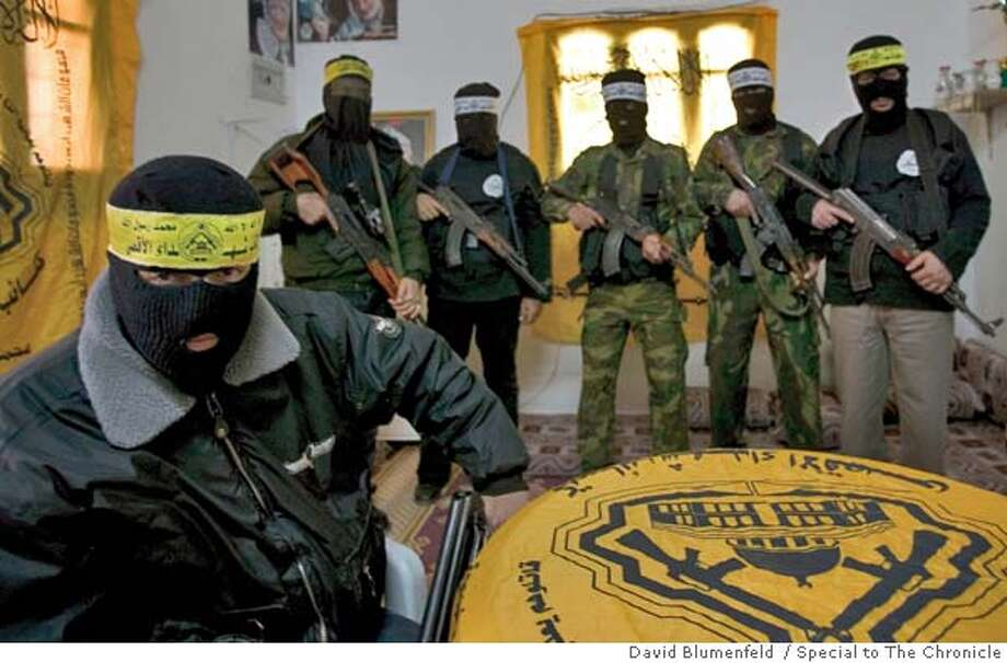 2005-02-21-Gaza: Abu Thaer, leader and spokesman of the Ayman Judeh Cell of the Katayib Al Aqsa (foreground left) with some of his fighters.  �David Blumenfeld /Special to The Chronicle Photo: David Blumenfeld /Special To The